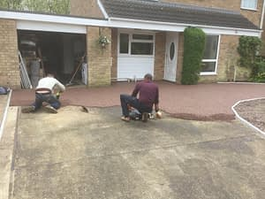 The Resin Being Installed on a Driveway