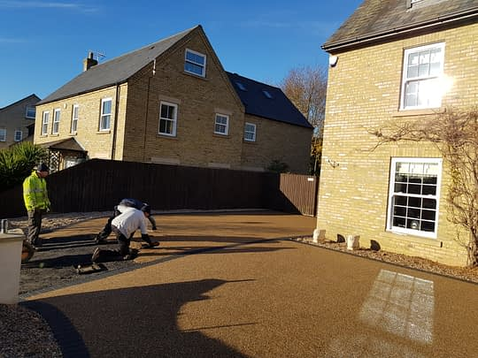 Resin being trowlled in Whittlesey