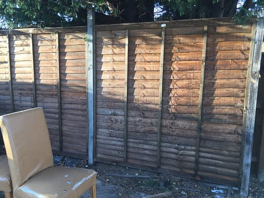 New waney fence panel fitted