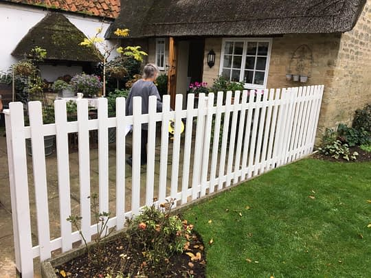Smooth Wood Picket Fence in White installed in Peterborough
