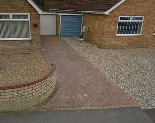 Old Damaged Resin Driveway in March Cambridgeshire