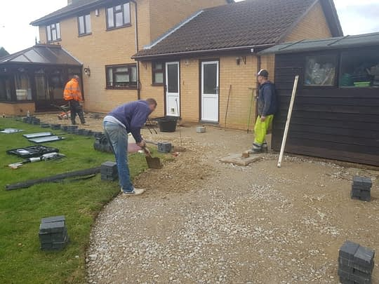 Block Edgings Being Installed for Resin Patio